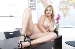 Latina teacher Jazmyn showing off great legs before undressing on office desk