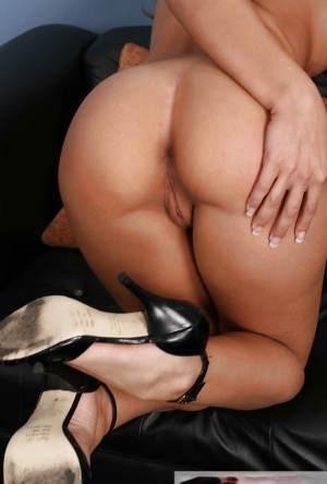 MILF pornstar Rachel Starr displaying bald twat and ass after undressing