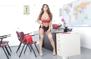 Sexy teacher Nikki Capone shucking skirt to masturbate on desk in stockings