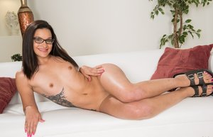 Young brunette nerd Eden Sin strips naked while wearing glasses 12391077