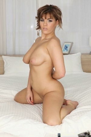 Naughty amateur Amy Wild strips off dress and thong for nude posing on bed