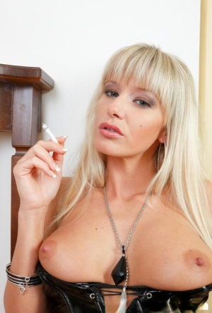 Platinum blond girl Natalli rips open her latex dress and pulls down her thong