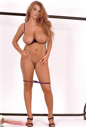 Blonde angel Ines Cudna shakes her naturals while getting ready for action