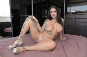 Tattooed Spanish model Raquel Adan shows off her generous assets in the nude