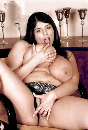 Busty Kerry Marie plays with the pussy and her large tits