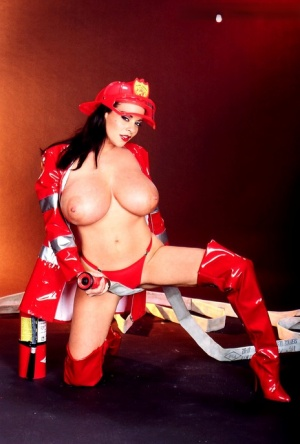 Salacious pornstar Linsey Dawn McKenzie licks her big fake boobs and toys twat