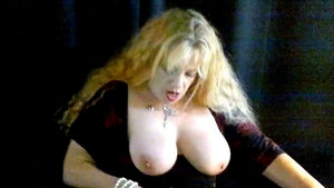 Older broad Lydia unveils big boobs and moist pussy wearing black stockings