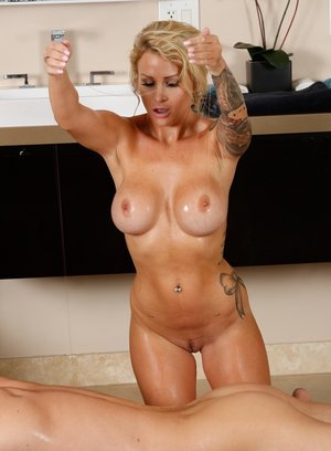 Busty and tattooed masseuse Daisy Monroe gets horny and fucks her client