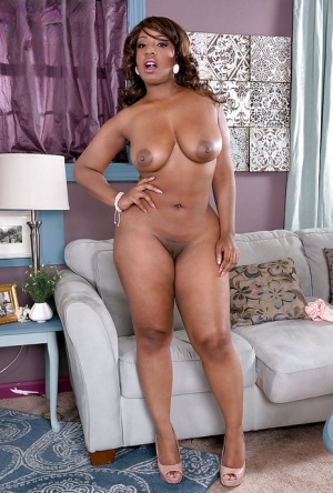 Layla Monroe shakes the big booty while rubbing her ebony pussy