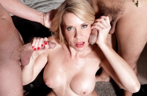 Sexy older lady Desiree Dalton strips before fucking and sucking 2 younger men
