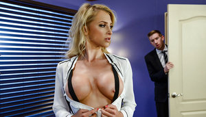 Kinky office chick Alix Lynx shows off her busty body in black nylon pantyhose