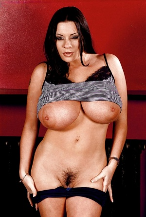 Hot Euro mom Linsey Dawn McKenzie uncovering knockers and trimmed muff