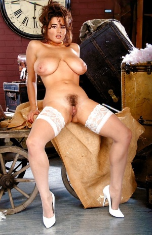 European MILF Chloe Vevrier showing off hooters and bush in white stockings