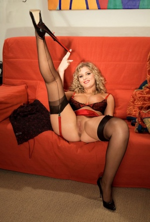 Sexy blonde wife Andrea masturbates with toy before removing garters and hose