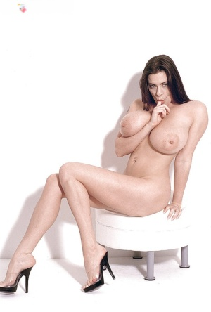 Euro boob model Linsey Dawn McKenzie posing naked after doffing leather skirt