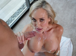 Pornstar Brandi Love finishes up a hard fuck with jizz on her face and tits