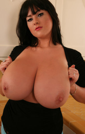 MILF Rachel Aldana feels the need to let her giant boobs loose from her shirt