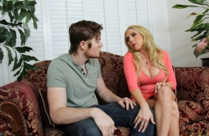 Blonde cougar Christie Stevens seduces younger boy and blows him tooo
