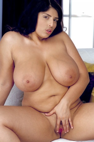 Dark haired female Kerry Marie unleashes her huge saggy boobs