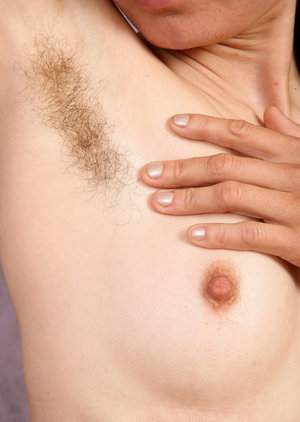 Hirsute older woman Kristina flaunts her unshaven pits and twat in home gym