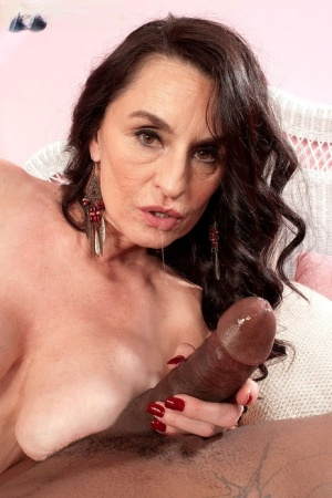 Nude older woman Rita Daniels sucks off a big black dick with ease
