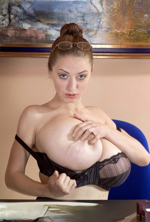 Office babe with massive boobs Merilyn Sakova plays a solo showing her jugs
