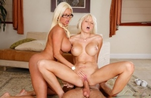 Big boobed stepmom and her stepdaughter have a threesome together