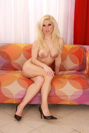 Sexy blonde doll Victoria Rush bares her big tits prior to showing her bush