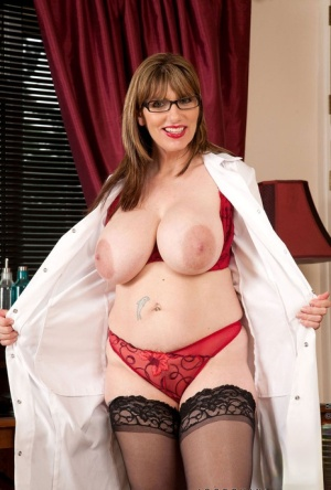 Chubby older lady Josephine James releases her hooters from her lab coat