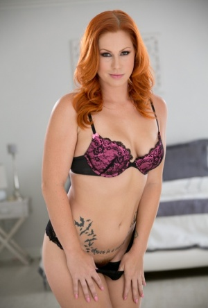Redhead female Edyn Blair takes off her bra and panties to model naked 99356000
