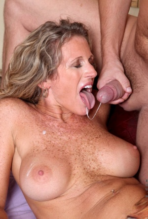 Mature hottie with big fake tits is happy to make love with a younger dude
