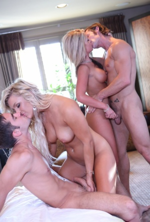 Hot blondes Embry Prada and Holly Taylor share a cum kiss after foursome sex