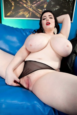 Solo model Jenna Valentine exposes her huge tits as she strips naked