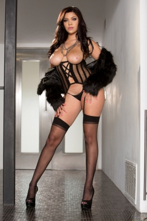 Latina solo model Cassidy Banks poses in an all black attire and high heels 51783685