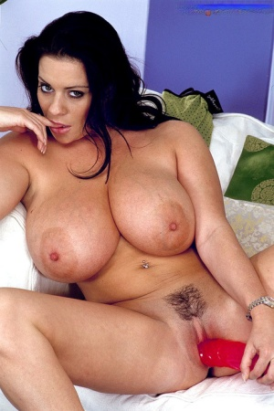 Raven-haired porn model with huge boobs Linsey Dawn McKenzie toys herself hard