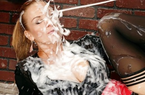 Clothed blonde chick Carol getting doused with massive amounts of semen