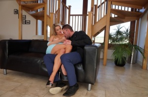 Blonde chick with great legs and big tits seduces a guy on a leather couch