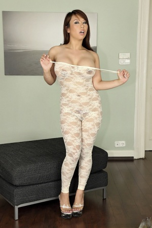 Sexy Asian MILF Tigerr Benson shows off her nipples and pierced pussy