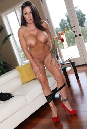 Dark haired chick Simone Garza peels off black skirt on her way to posing nude