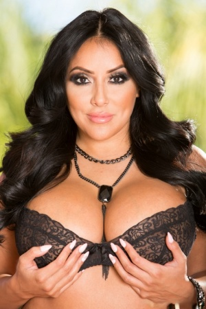 Sexy Latina model Kiara Mia shows off her big boobs in nylons and garters