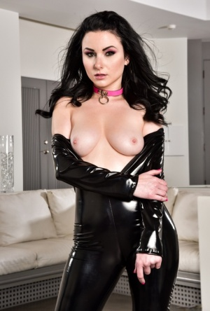 Solo girl Veruca James strips off her latex catsuit for nude posing