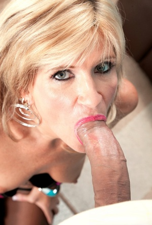 Middle-aged blonde woman Crystal Jewels sucks off her younger lover