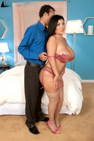 Latina female with massive boobs and a big butt sucks a cock on her knees