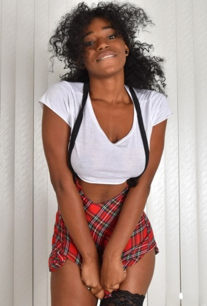 Black girl Rea Quinn removes her schoolgirl themed attire to pose nude