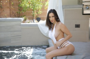 Brunette chick Ashley Adams reveals her nice tits as she removes her swimsuit 20514646
