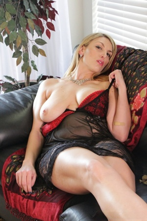 Blond chick whips out her big boobs before toying her vagina