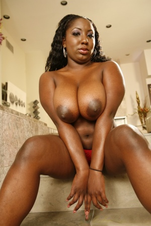 Black fatty Luxury Amore gets her juicy ass and tits oiled up