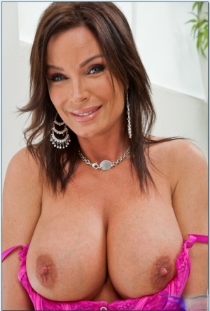Gorgeous MILF babe Diamond Foxxx poses in pink lingerie and naked