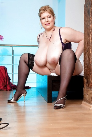 BBW Angellyne Hart posing in stockings and brings out giant boobs