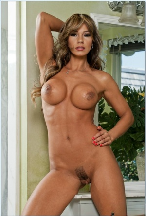 Latina MILF with huge tits Esperanza Gomez flashes her hairy pussy
